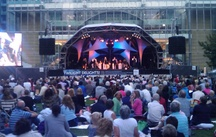 The orchestra and The Jiving Lindy Hoppers on stage at Canary Wharf.